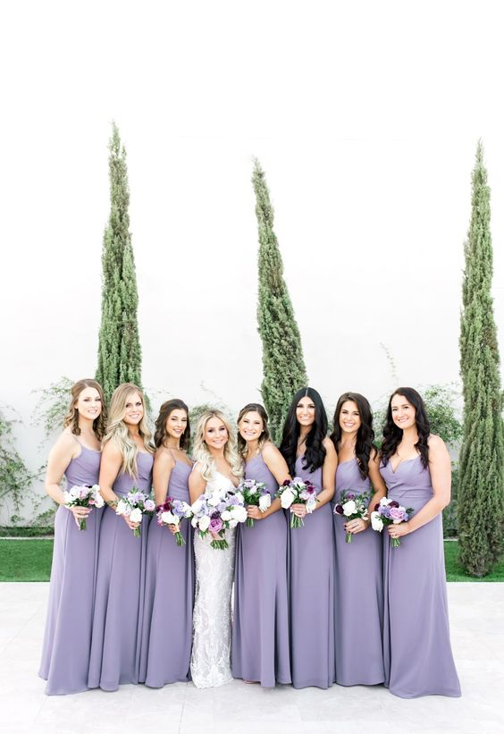 fitting lilac maxi bridesmaid dresses with spaghetti straps are a cool and very romantic idea