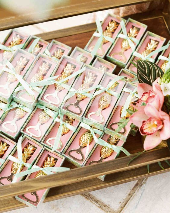 glam gold pineapple bottle openers packed in pink boxes are lovely and practical tropical beach wedding favors