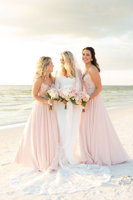 glam light pink A-line bridesmaid dresses with embellished bodices and spaghetti straps are romantic and bright