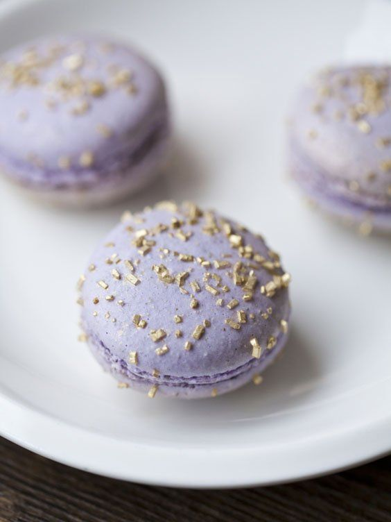 lilac macarons with edible gold touches on top are super glam, fun and chic