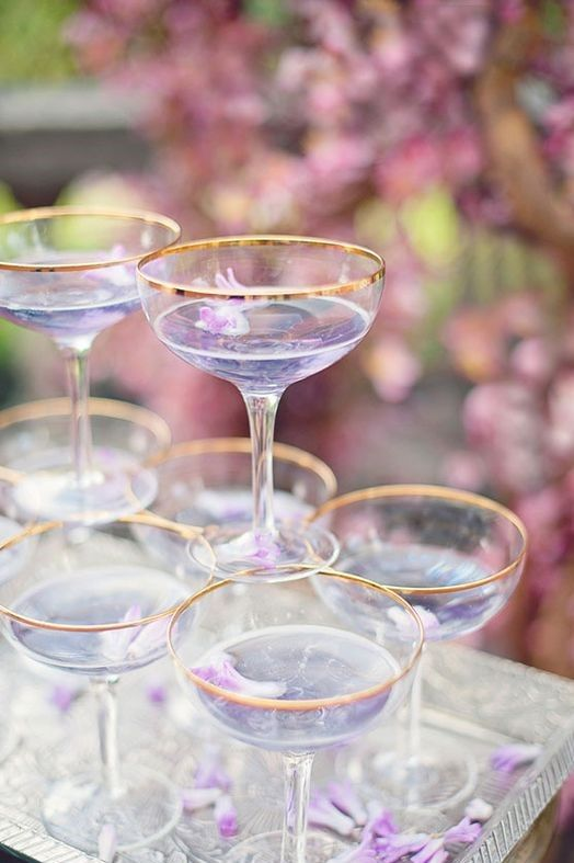lilac signature drinks with petals of edible flowers are amazing for spring and summer