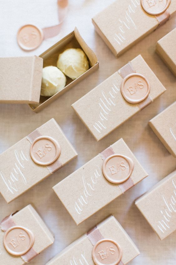 lovely boxes with white chocolate truffles are delicious wedding favors suitable not only for beach weddings