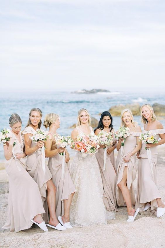 mismatching blush maxi bridesmaid dresses with ruffles and deep necklines look lovely and very chic