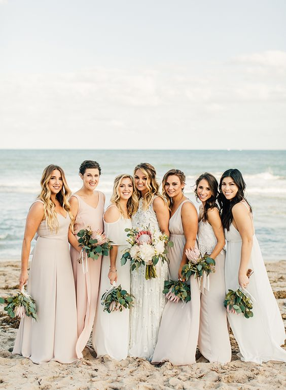 mismatching blush, off-white and white embellished maxi bridesmaid dresses show off the style of each girl perfectly