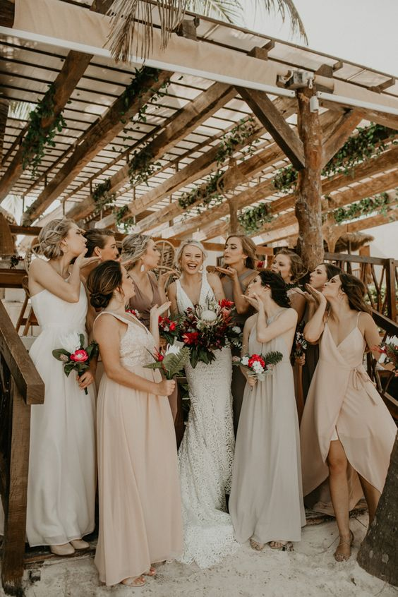 mismatching blush, off-white, white and taupe maxi bridesmaid dresses for a relaxed beach tropical wedding