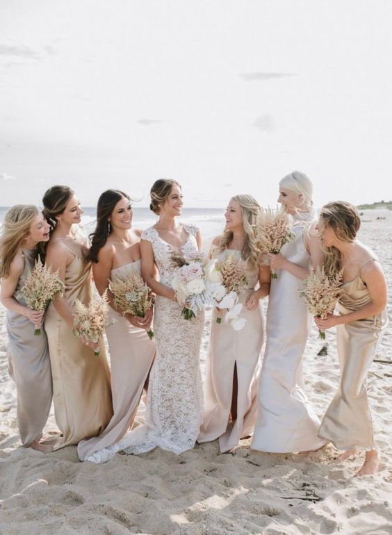 mismatching metallic and neutral maxi bridesmaid dresses with various necklines and slits look cool and trendy