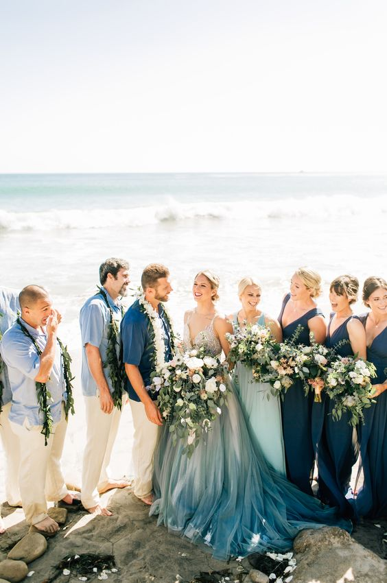 navy sheath maxi bridesmaid dresses with thick straps and deep V-necklines plus trains for a beach or coastal wedding