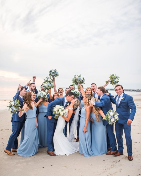 pastel blue maxi bridesmaid dresses with spaghetti straps and draped waists look chic and elegant