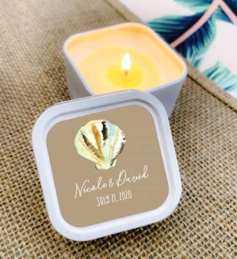 personalized beach candles in jars with lids, a gold seashell are a wonderful beach wedding idea