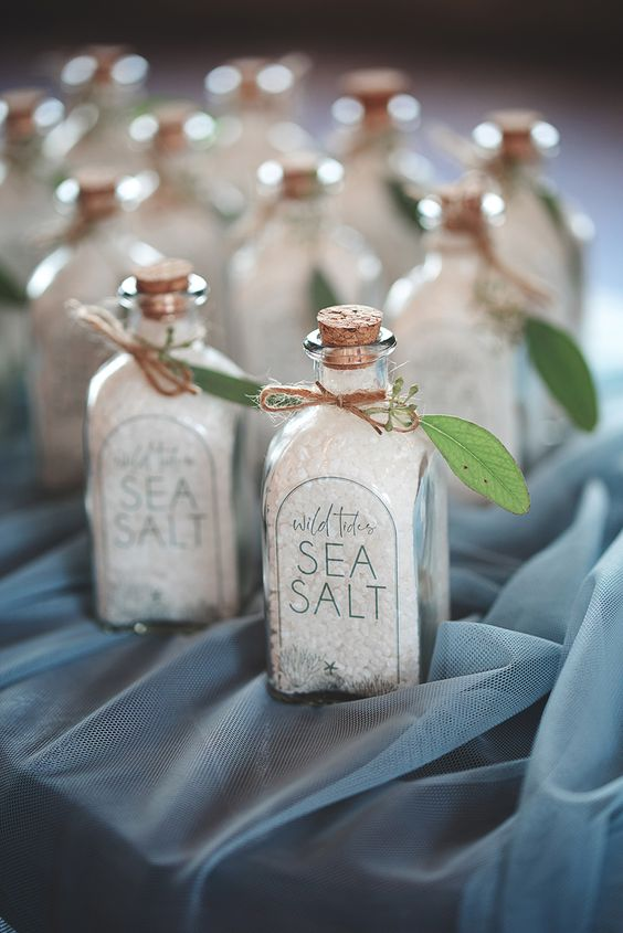 sea salt in bottles with leaves and tags are amazing beach wedding favors and they won't break the bank