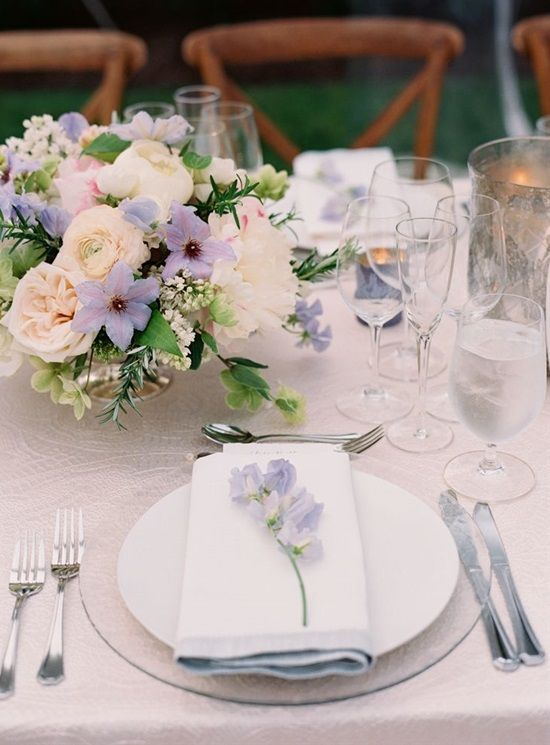 some lilac-colored blooms in the centerpiece and on each palce setting to make it chic and stylish