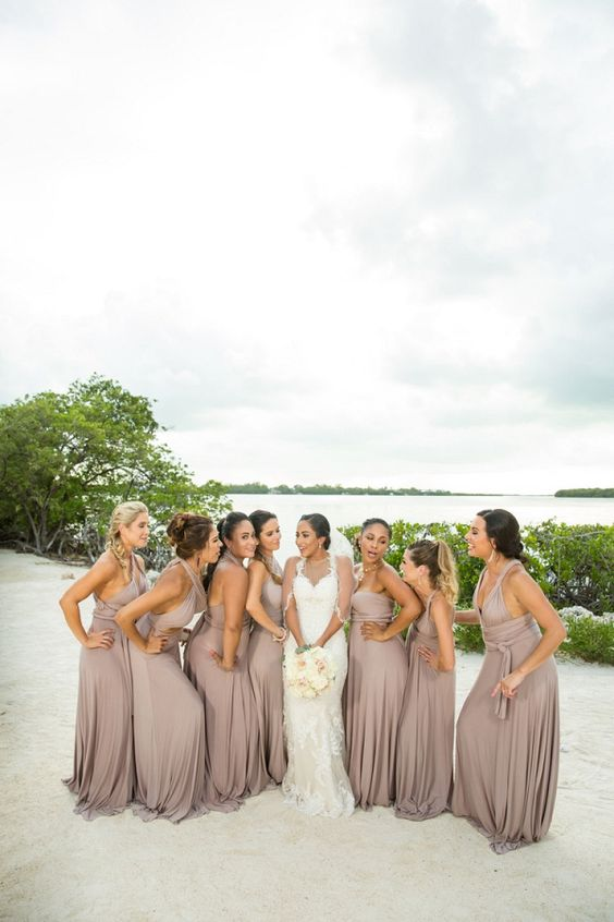taupe maxi bridesmaid dresses with thick straps and deep V-necklines and pleated skirts for a beach wedding
