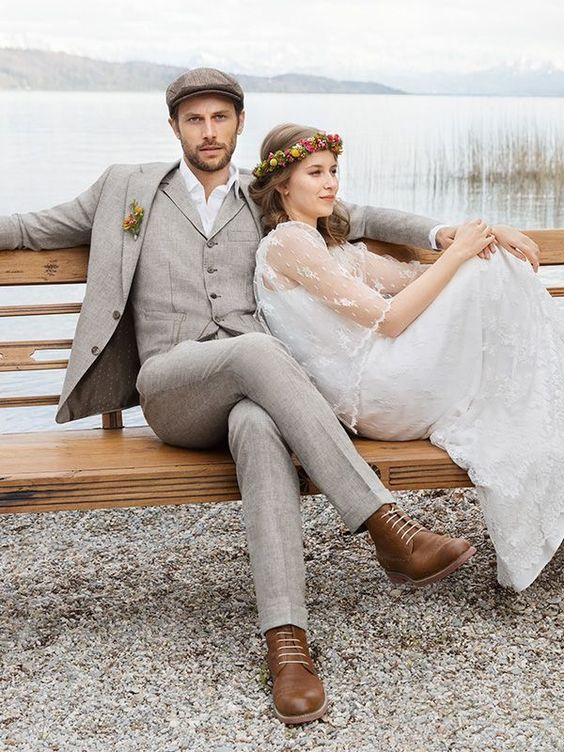 a grey three-piece suit, a white shirt, a brown cap and brown shoes for a vintage-inspired groom's look