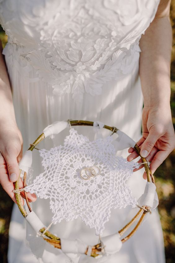 a macrame attached to branches is a cool idea for a boho wedding, attach your rings on top