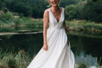 a minimalist wedding ballgown with a plunging neckline, thick straps and a train for a modern romantic bride