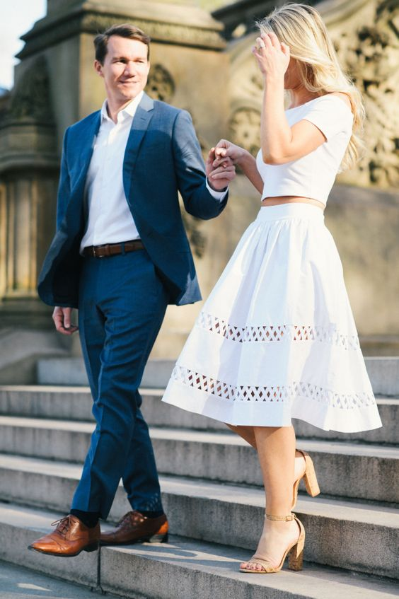a modern white separate with a crop top, a perforated A-line midi skirt and nude heels