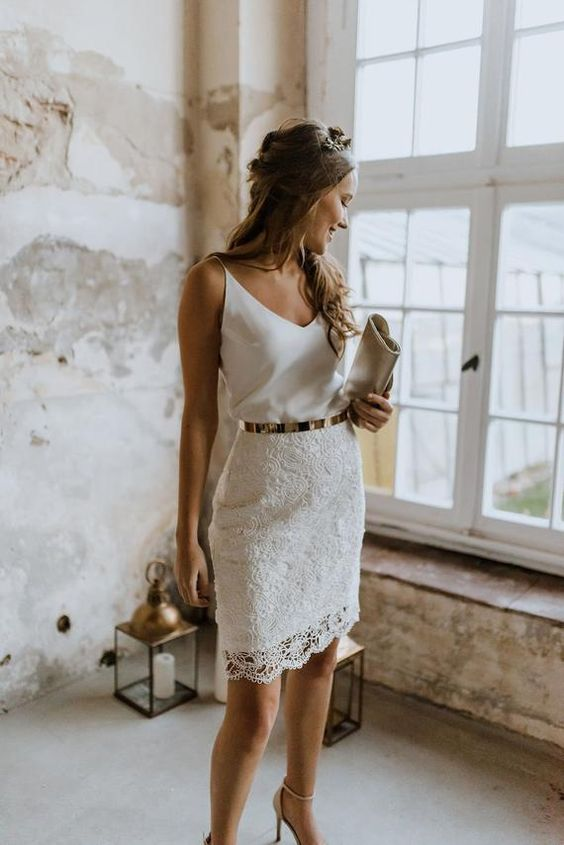 a simple modern look with a white spaghetti strap top, a lace skirt, a metallic belt and a clutch