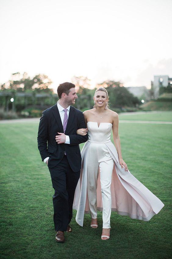 a stunning minimalist strapless jumpsuit with a skirt and nude heels for a gorgeous rehearsal dinner look