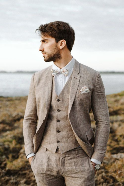 a vintage-inspired groom's look with a tan linen three-piece suit, a white shirt, a florla bow tie and a matching handkerchief