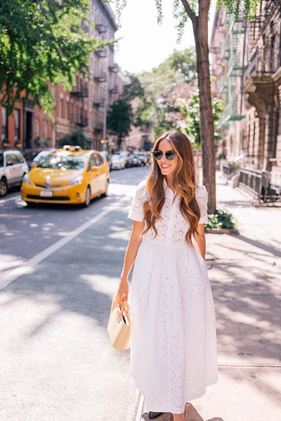 a vintage-inspired white lace midi dress with short sleeves and a full skirt is an elegnt option