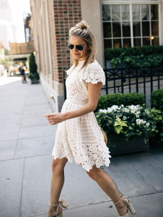 a white lace A-line knee dress with a high neckline, cap sleeves and fringe block heels for a chic and comfy look
