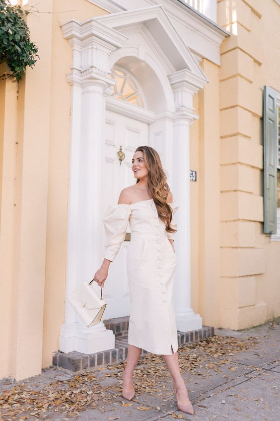 an off the shoulder button up midi dress with long puff sleeves, pockets, nude heels and a small bag
