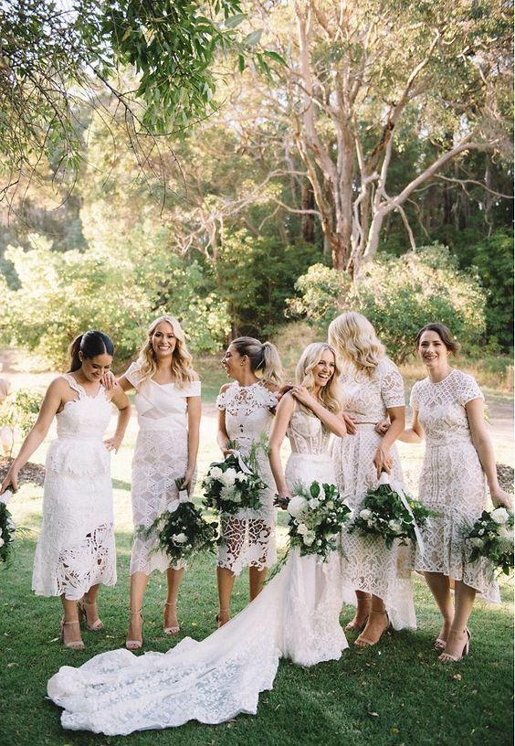 mismatching and super elegant white lace bridesmaid dresses with all kinds of designs for a glam boho white wedding