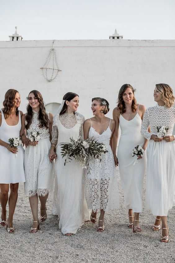 mismatching boho lace and plain white bridesmaid dresses will let each bridesmaid express her style and choose the best look