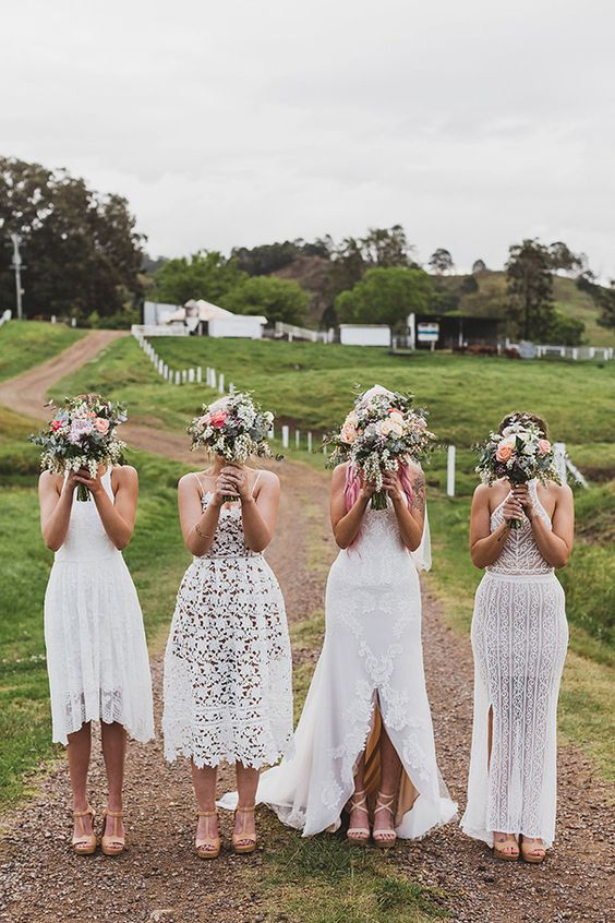 mismatching white boho lace bridesmaid dresses will fit a boho wedding and will help you pull off a trendy mismatching look