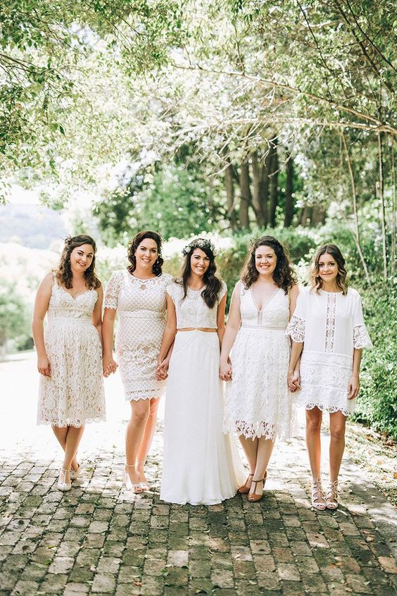 mismatching white boho lace knee and mini bridesmaid dresses with various necklines, silhouettes and sleeves to look ultimate