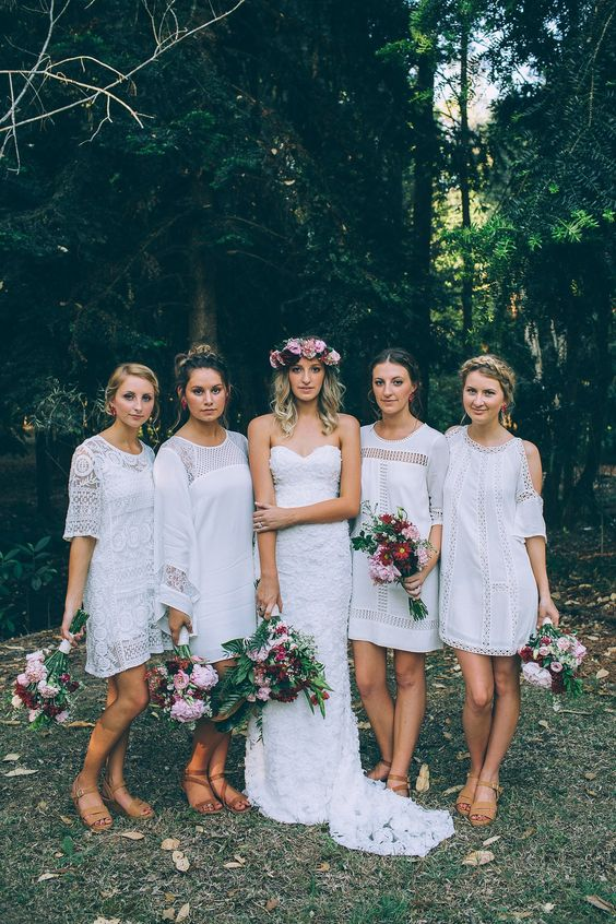 musmatching white boho lace mini dresses inspired by the 70s are great for a hippie or a 70s inspired wedding
