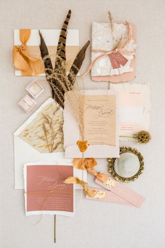 a beautiful pastel and earthy wedding invitation suite in blush, neutrals, beige and ribbons of these colors