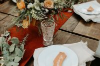 a stylish boho wedding tablescape with fall touches