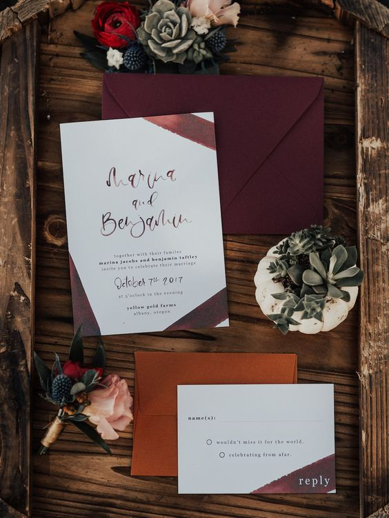 a bold and stylish wedding invitation suite with a burgundy envelope, painted burgundy ribbons