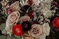 a bold fall wedding bouquet of hot red, lilac, white and deep purple blooms, greenery and seeded eucalyptus for a bold fall wedding