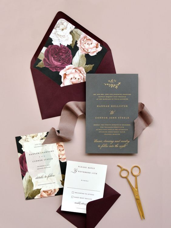 a bold fall wedding invitation suite with a burgundy envelope, bright floral lining and a grey invite plus a ribbon