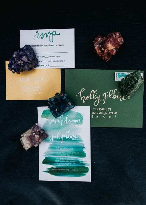 a bold wedding invitation suite with a green and yellow envelope and an invite with green brushstrokes