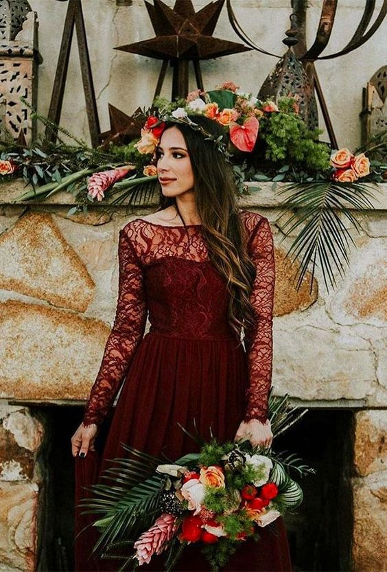 a burgundy lace wedding dress with an illusion neckline and long sleeves for a fall bridal look