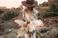 a copper sequin sheath wedding dress with a V-neckline and long sleeves plus a hat for a boho look