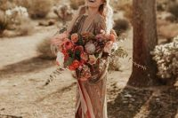 a copper wedding dress with silver glitter stripes, a deep neckline and a slit, silver mules for a chic and refined look