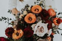 a dimensional fall wedding bouquet of orange, burgundy, lilac and pale pink blooms, greenery is a lovely idea for a bold or moody fall wedding