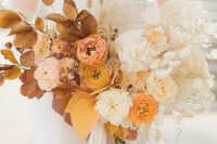 a fab ombre wedding bouquet from rust tp peachy and blush, yellow marigold and white, with foliage, bunny tails, leaves is amazing for a modern fall wedding