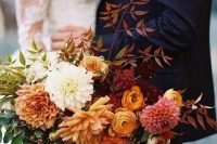 a colorful bouquet works even for a fall wedding