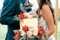 a fantastic white and teal wedding cake with copper drizzle, obre macarons and blush and rust-colored blooms