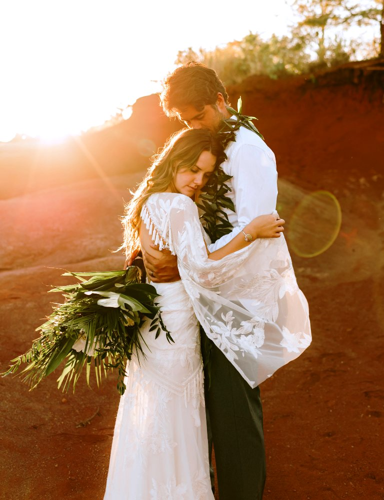 a fitting boho lace wedding dress with appliques and tassels, a cutout back and bell sleeves for a boho elopement