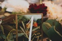a glass framed table number with some greenery inside is a lovely idea for many types of fall weddings