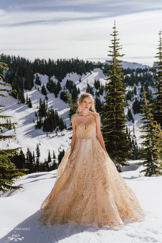 a gold wedding ballgown with an illusion neckline for a winter mountain elopement looks wow