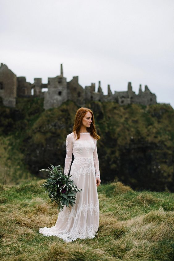 a lovely A-line lace wedding dress with an illusion neckline, long sleeves and a train for a castle elopement