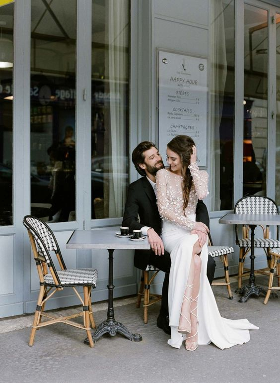 a modern A-line wedding dress with an applique bodice, a plain skirt with a slit, lace up shoes for a city elopement