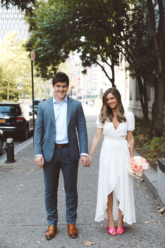a modern city hall elopement wedding dress - a white wrap dress with a ruffle edge, pink mules for a trendy look